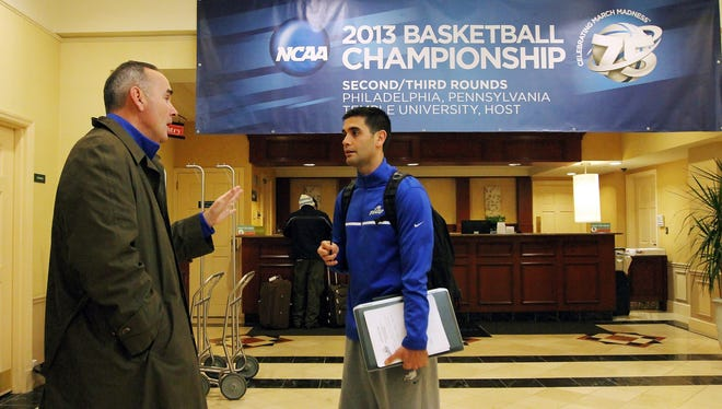 FGCU Director of Athletics, Ken Kavanagh, left, and Director of Basketball Operations, Joey Cantens, review the team's schedule Thursday morning at the team's hotel at the NCAA men's basketball tournament in Philadelphia.