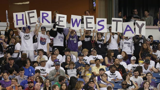 Sacramento Kings fans show support to keep the team from moving during a timeout in the third quarter of an NBA basketball game against the Philadelphia 76ers in Sacramento, Calif., Sunday, March 24, 2013.