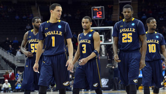 The La Salle Explorers walk out onto the court after a time-out against the Mississippi Rebles in the second half during the third round of the NCAA basketball tournament at the Sprint Center. La Salle defeated Mississippi 76-74.