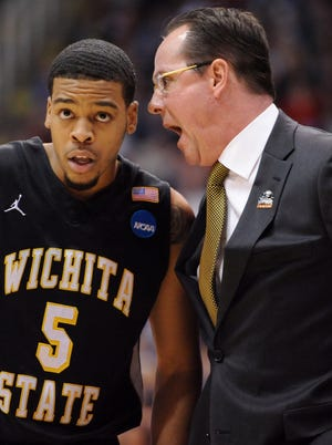 Wichita State Shockers coach Gregg Marshall speaks with guard Demetric Williams in the first half of the game against the Gonzaga Bulldogs during the third round of the NCAA basketball tournament at EnergySolutions Arena.