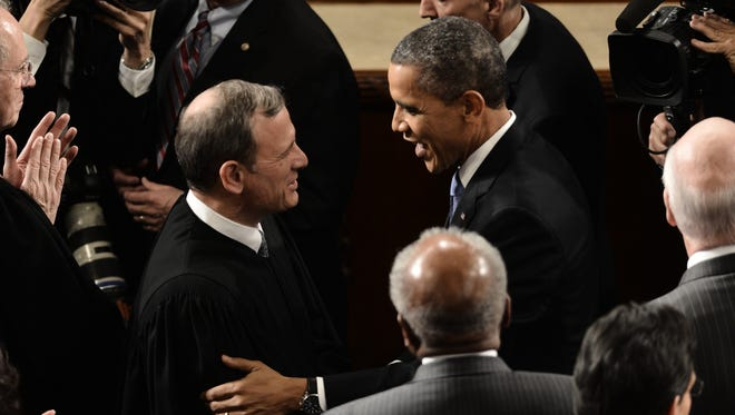 President Obama and Chief Justice John Roberts chat before the State of the Union Address on Feb. 12