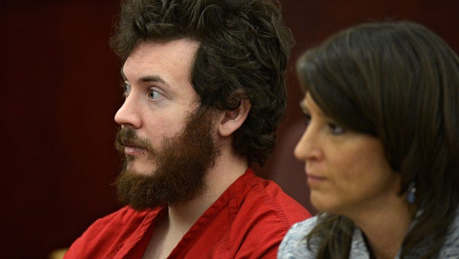 James Holmes, with defense attorney Tamara Brady, appears in court in Centennial, Colo., for his March 12 arraignment in the July mass killing at a Denver-area movie theater.