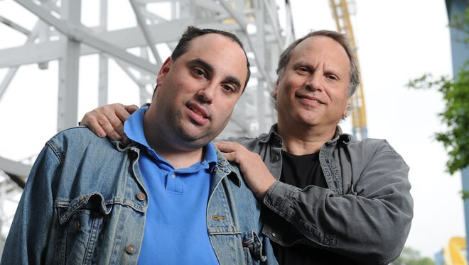 Buzz Bissinger and his son Zach at Hersheypark in 2012.