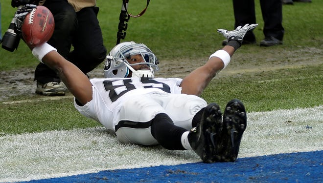 Oakland Raiders wide receiver Darrius Heyward-Bey motions to the officials after a touchdown catch in the end zone against the San Diego Chargers during the first half of an NFL football game Sunday, Dec. 30, 2012, in San Diego.
