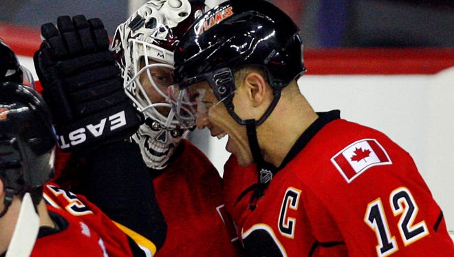 Calgary Flames captain Jarome Iginla, right, was dealt to the Penguins while goalie Miikka Kiprusoff says he won't report if traded.