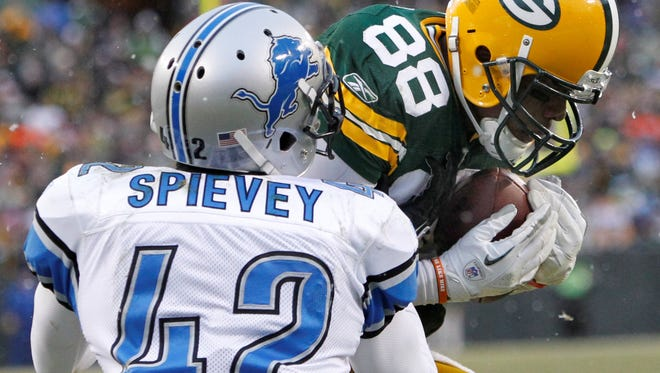 Amari Spievey, covering the  Packers' Jermichael Finley on Jan. 1, 2012, was drafted by the Lions in  2010.