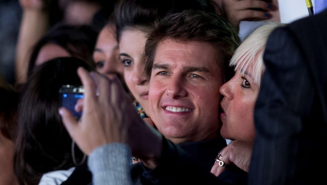 A fan plants one on Tom Cruise in Argentina Tuesday.