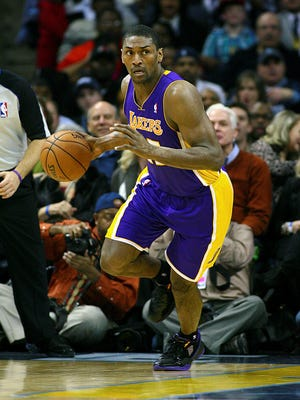 Lakers forward Metta World Peace, shown Jan. 23, will be out for six weeks after he has knee surgery.