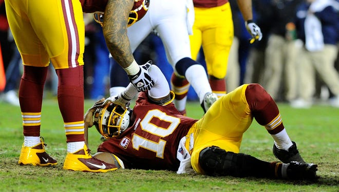 QB Robert Griffin III tore two knee ligaments in the Redskins' Jan. 6 playoff loss to the Seahawks.