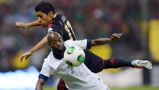 United States midfielder DaMarcus Beasley (7) and Mexico midfielder Jesus Zavala (11) battle for the ball in a World Cup qualifying match at Estadio Azteca. The two teams played to a 0-0 draw.
