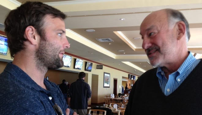 Wes Welker, left, talks to Shanghai Bobby owner Jack Wolf after the post-position draw Thursday for the $1 million Florida Derby.