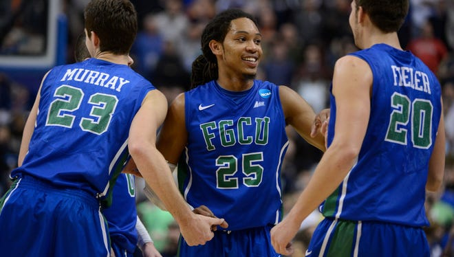 Florida Gulf Coast forward Eddie Murray, left, guard Sherwood Brown, center, and forward Chase Fieler celebrate during final moments of their win over Georgetown in the second round at the Wells Fargo Center.