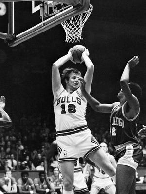Late Bulls center Tom Boerwinkle grabs a rebound during a 1970 game.