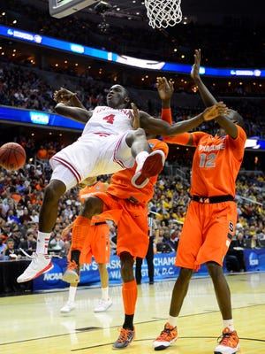 Indiana Hoosiers guard Victor Oladipo (4) falls to the ground against the Syracuse Orange during the first half of the semifinals of the East regional of the 2013 NCAA Tournament at the Verizon Center.