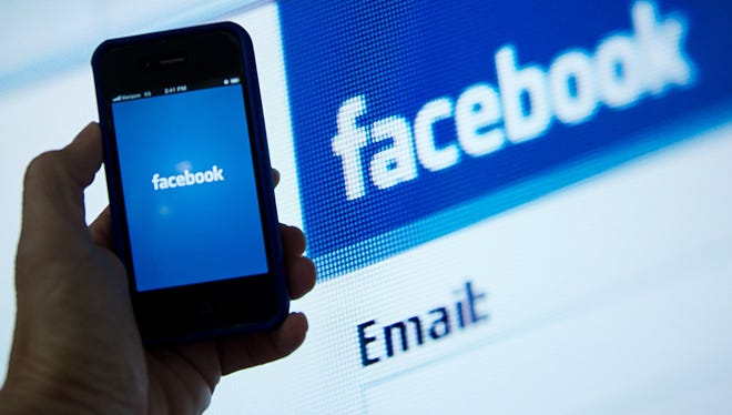 A view of the Facebook app's splash screen in front of the login page.