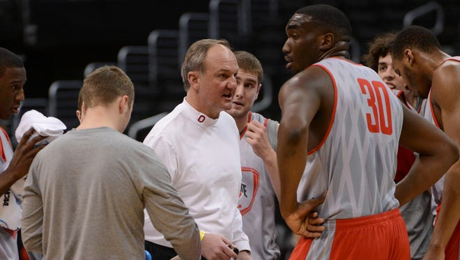 Ohio State head coach Thad Matta instructs his team in practice prior to facing off against the Arizona Wildcats, coached by good friend Sean Miller, in the Sweet 16.
