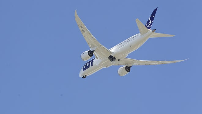 A LOT Polish Airlines Boeing 787 Dreamliner with a redesigned lithium-ion battery performs a test flight on March 25, 2013, at Paine Field in Everett, Wash.