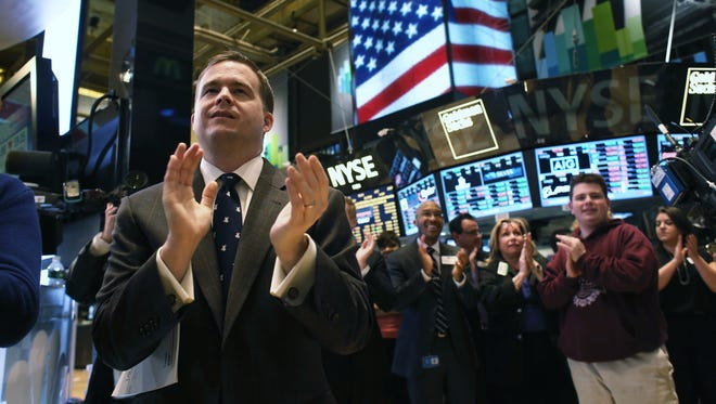 Nope. They aren't applauding the new S&P 500 intraday high on March 28, 2013. But they are applauding in this file photo from March 25.