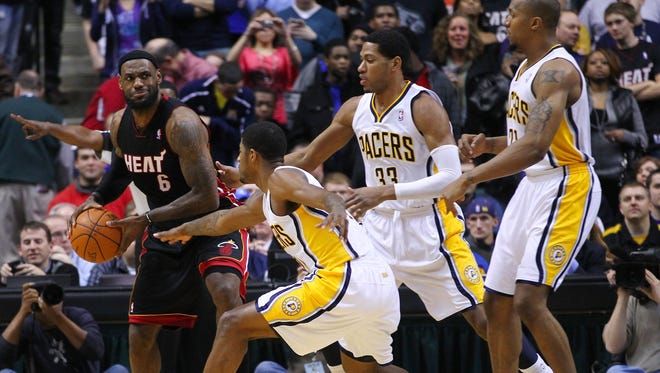 Miami Heat small forward LeBron James (6) tries to pass off the ball against Indiana Pacers shooting guard Paul George (24) Indiana Pacers small forward Danny Granger (33) and Indiana Pacers power forward David West (21). The Pacers expect to get those three guys back in the lineup.