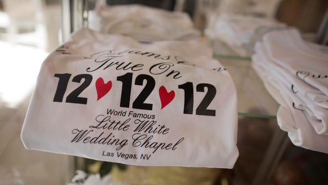 Shirts advertising the 12-12-12 date sit on display at Little White Wedding Chapel, in Las Vegas.