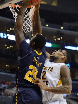 Wichita State Shockers forward Carl Hall (22) defends against La Salle Explorers forward Jerrell Wright (25) during the second half of the semifinals of the West regional of the 2013 NCAA tournament at the Staples Center.