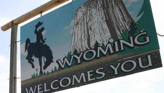 A sign along Interstate 90 welcomes travelers to Wyoming.