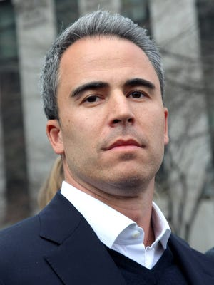 SAC Capital portfolio manager Michael Steinberg leaves federal court after being arraigned on insider trading charges on March 29, 2013 in New York City.