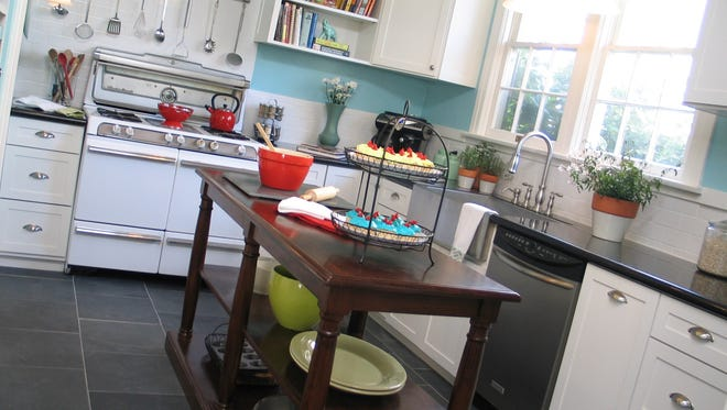 This kitchen was transformed to reflect the homeowner's personal style in bold colors, her love for ceramics and her taste for modern, clean lines.