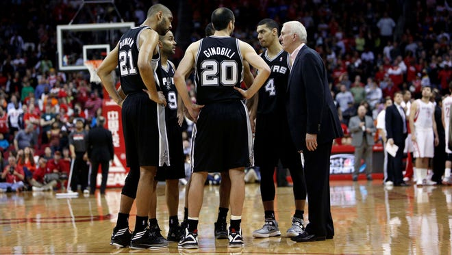 Spurs coach Gregg Popovich, right, shown March 24, sent home (from left) Tim Duncan, Tony Parker, Manu Ginobili and Danny Green before a game at the Heat earlier this season.