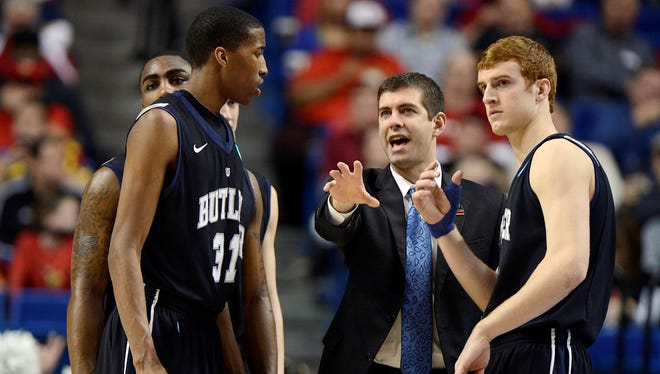 Butler coach Brad Stevens talks with his players in the first half of a loss to Marquette during the third round of the NCAA tournament on March 23 at Rupp Arena.
