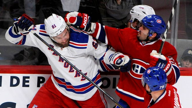 New York Rangers forward Rick Nash tussles with Montreal Canadiens forward Brian Gionta during the third period. The Canadiens won 3-0.
