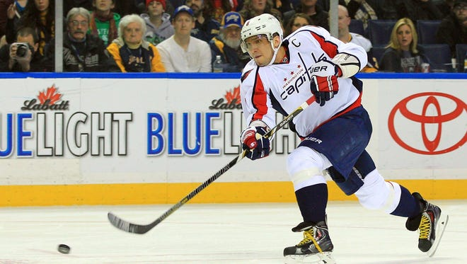 Washington Capitals left wing Alex Ovechkin fires a slap shot during the first period against the Buffalo Sabres. Ovechkin scored during regulation and in the shootout in the 4-3 win.