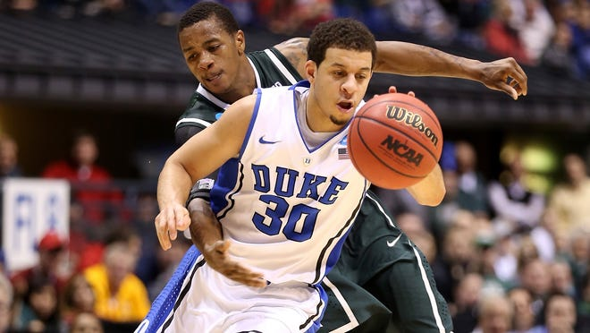 Duke's Seth Curry drives past Keith Appling of Michigan State in the second half during the Midwest Region semifinal in Indianapolis on Friday. The Dukes will be underdogs against Louisville in the final on Sunday.