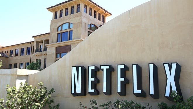 A sign stands in front of the Netflix headquarters in Los Gatos, Calif.  The firm, which earns only 3% of its revenue outside the U.S., has seen its stock price climb by 104% this year.