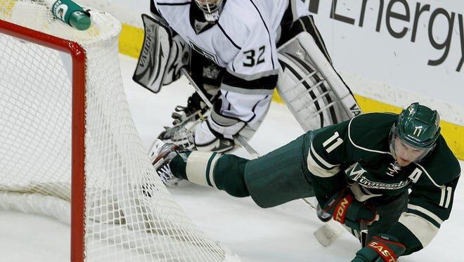 Minnesota Wild left wing Zach Parise shoots on an empty net as Kings goalie Jonathan Quick tries to get back in position. The Wild defeated Los Angeles 4-3 in a shootout.