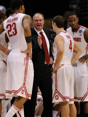 Ohio State Buckeyes coach Thad Matta, center, instructs in a huddle against the Wichita State Shockers during the second half of the finals of the West regional of the NCAA tournament at the Staples Center.