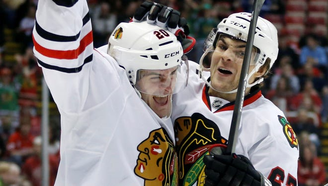 Brandon Saad, left, had two goals and an assist Sunday for the Blackhawks in their win over the Red Wings.