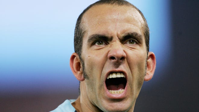 Lazio's forward Paolo Di Canio grimacing to Lazio fans during Lazio vs AS Roma Serie A football match in 2005. Paolo Di Canio was appointed the new manager of Premier League side Sunderland on March 31, 2013, replacing Martin O'Neill who was sacked 24 hours earlier.