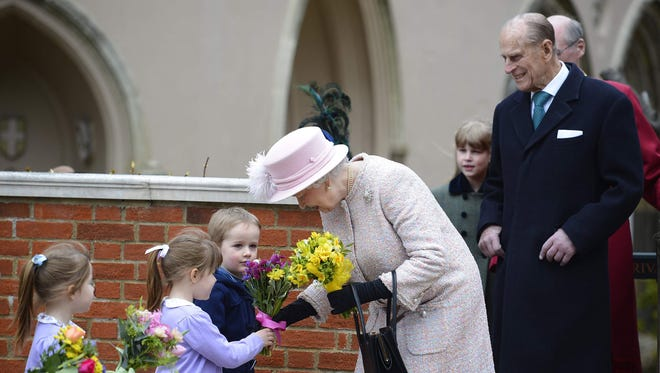 Queen Elizabeth II and Prince Philip, Duke of Edinburgh leave the Easter service at St. George's Chapel on the grounds of Windsor Castle on March 31, 2013, in Windsor, England.