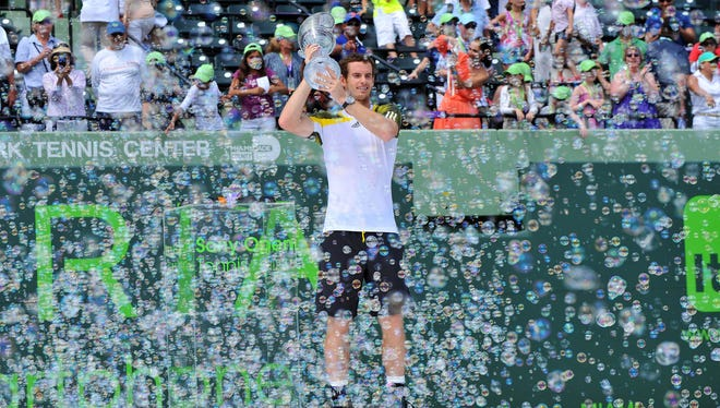 Andy Murray of Britain, his trophy and the celebratory bubbles following his victory Sunday against David Ferrer in the Sony Open final.