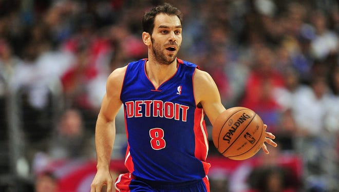 Pistons point guard Jose Calderon drives up the court March 10.