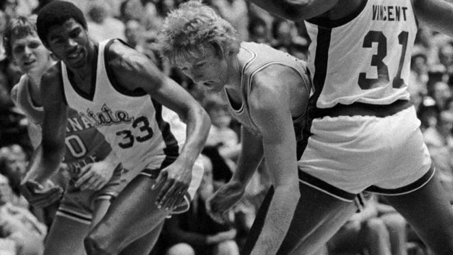 Michigan State's Earvin Johnson, left, got the best of Indiana State's Larry Bird as the Spartans beat the Sycamores 75-64 for the 1979 national title in Salt Lake City.