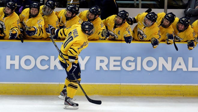 Quinnipiac left wing Matthew Peca, front, celebrates with teammates after scoring his third goal in the first period of the NCAA college hockey tournament East regional final game against Union.