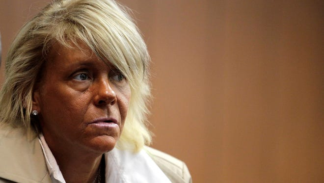 Patricia Krentcil, 44, waits to be arraigned on May 2 at the Essex County Superior Court in Newark, N.J., where she appeared on charges of endangering her 5-year-old child by taking her into a tanning salon.