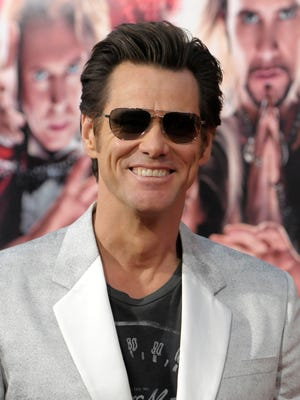Actor Jim Carrey arrives at the world premiere of the film 'The Incredible Burt Wonderstone.' He is self-publishing a book.