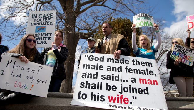 Protesters against and for same-sex marriage demonstrate outside the Supreme Court on Wednesday.