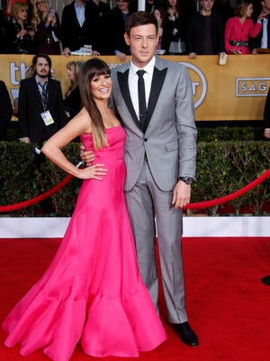Lea Michele and Cory Monteith arrive at the Screen Actors Guild awards on Jan. 25 at the Shrine Auditorium in Los Angeles.