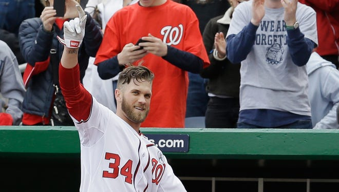 Harper waves to the crowd after hitting a his second home run of the game.