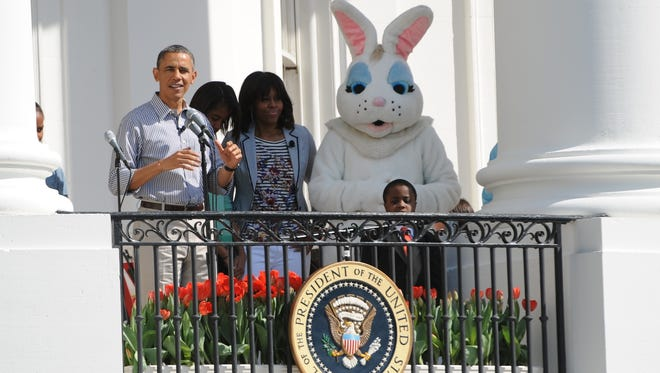 President Obama, first lady Michelle Obama, and the Easter Bunny.