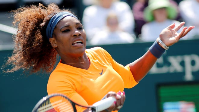 Serena Williams fires a forehand during her 6-2, 6-3 victory against Camila Giorgi of Italy.